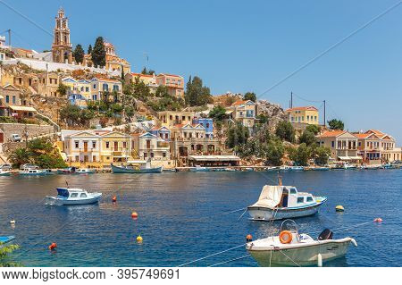 Simi-greece-july 04, 2011: View Of The Bay, Beautiful Colorful Houses And Fishing Boats Of Simi Isla