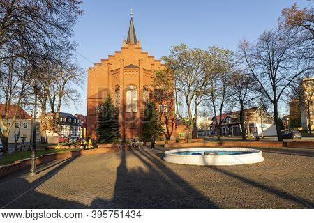 Jastrowie, Wielkopolskie / Poland - November, 20, 2020: Old Catholic Church In The Center Of A Small