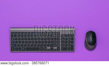 Modern Stylish Wireless Keyboard And Mouse On A Lilac Background. Peripheral Devices For The Compute