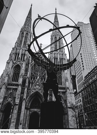 11/21/2020: A Rear Angle Shot Of The Statue Of Atlas Facing The Cathedral Church On 5th Avenue In Ma