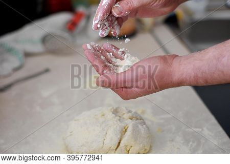 Close Up Human Hands Making Pastry From Raw Dough/ Bread Making Process. Closeup Of Man Hands Kneadi