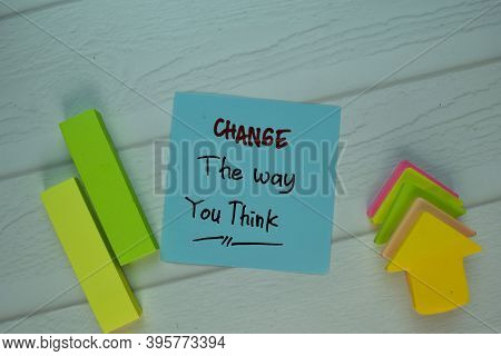 Change The Way You Think Write On Sticky Notek Isolated On Wooden Table. Selective Focus On Change T