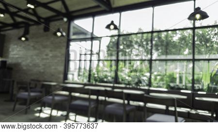 Blur Coffee Shop Or Cafe Restaurant With Abstract Bokeh Light Image Background, Quiet And Chill Cafe