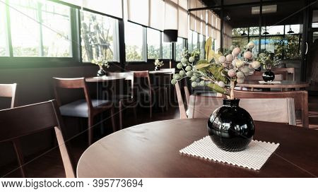 Close Up Imitation Flower Vase In Cafe Restaurent, Modern Interior Chair And Table In Cafe Restauren