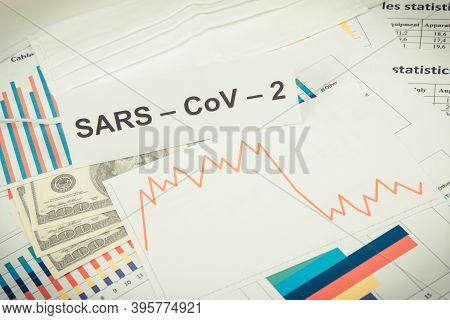 Inscription Sars-cov-2, Currencies Dollars And Downward Graphs Representing Financial Crisis Caused