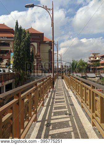 Denpasar, Indonesia - October 5, 2019: Pedestrian Bridge Over The Tukad Badung Outside Badung Market