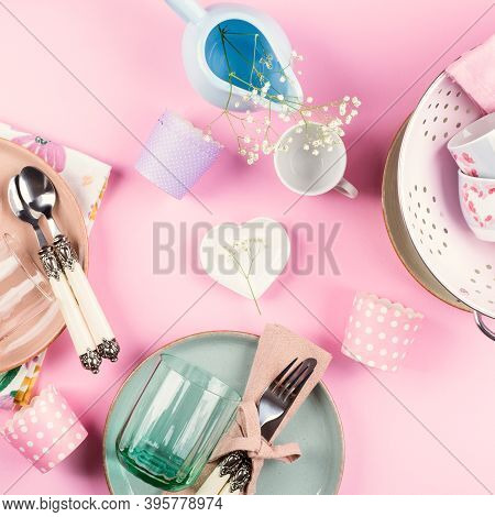 Pastel Color Ceramic And Glass Tableware With Floral Decor On Pink Background. Flat Lay With Modern