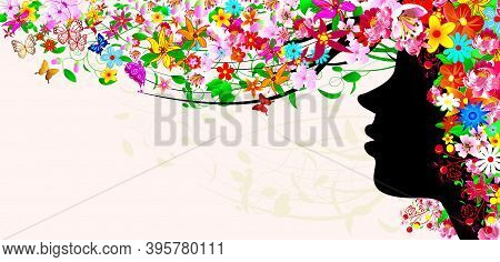 Silhouette Of A Woman's Face Among Flowers And Butterflies. The Girl's Head Is Covered With Flowers