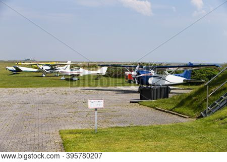 The Photo Of The Baltrum Airfield With Parked Planes In Daylight
