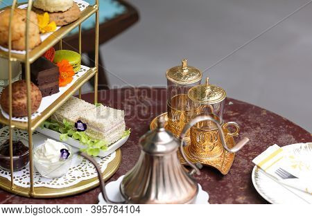 Beautiful Afternoon Tea Set With Desserts And Snacks.