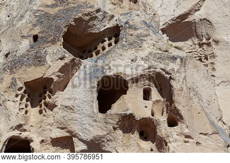 Uchisar, Turkey - October 4, 2020: This Is A Part Of The Surface Of A Tuff Rock With Traces Of Carve