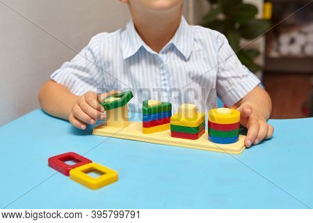The Boy Is Playing In His Room. Learning Shapes And Colors. A Child Plays With A Sorter. Educational