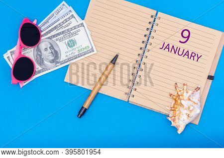 9 January. 9th Day Of January. Travel Plan Flat Design With Notepad Written Date, Pen, Glasses, Mone