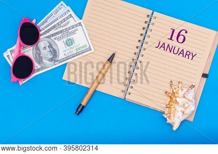 January 16. 16th Day Of January. Travel Plan Flat Design With Notepad Written Date, Pen, Glasses, Mo