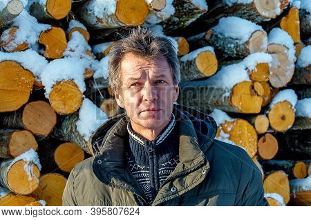 Freshly Cut Logs And Firewood From Loggers Submerged Under A Blanket Of White Snow During The Winter