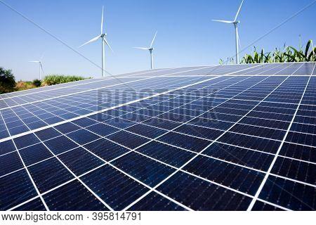 Solar Energy In Sugar Farm And Wind Mill Or Wind Turbine