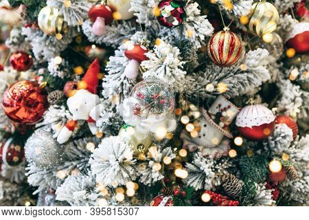 Christmas Holiday Tree With Many Balls, Toys And Other Baubles And Holiday Lights. Christmas Backgro
