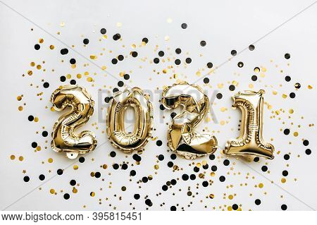 Golden Inflatable Holiday Numbers 2021 On White Background With Golden Confetti Christmas Or New Yea