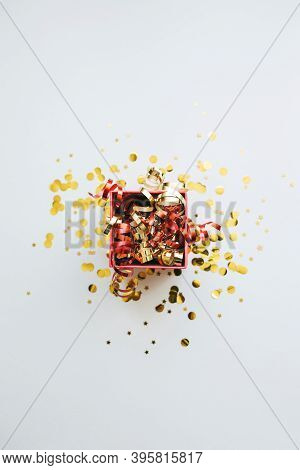 Open Festive Box With Tinsel And Confetti. Celebrating Christmas Or New Years Or Winning A Prize Or
