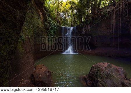 Waterfall Landscape. Beautiful Hidden Waterfall In Tropical Rainforest. Foreground With Big Stone. S