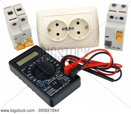 Electrical Modular Circuit Breaker, Electrical Outlet And Digital Multimeter On White Background