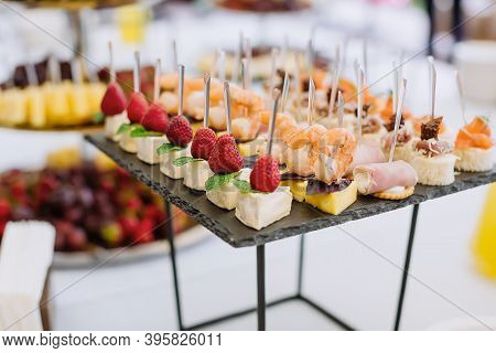 Different Light Snack Appetizer On Tray At The Table