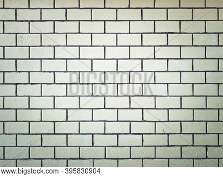 Yellow Brick Wall With Grunge Background And Vignetted.