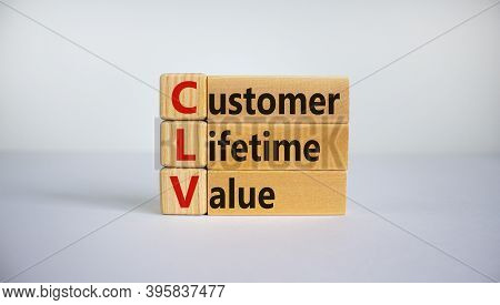 Concept Words 'clv, Customer Lifetime Value' On Cubes And Blocks On A Beautiful White Background. Bu