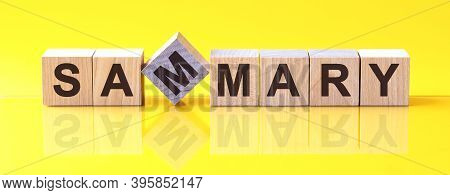 Sammary Word Is Made Of Wooden Building Blocks Lying On The Yellow Table, Concept
