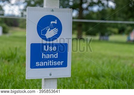 A Sign Asking Visitors To Use Hand Sanitiser At An Outdoor Event As The Coronavirus Lockdown Eases I