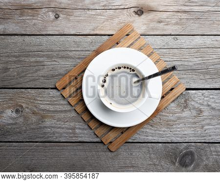 A Cup Of Hot Coffee On Old Wooden Table In A Cafe. White Cup Of Coffee In The Morning.