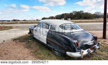 Frederickburg,texas - Nov.11,2020   The Rear End Of A 1950 Hudson Super 6 Police Car With A 1950 Tex