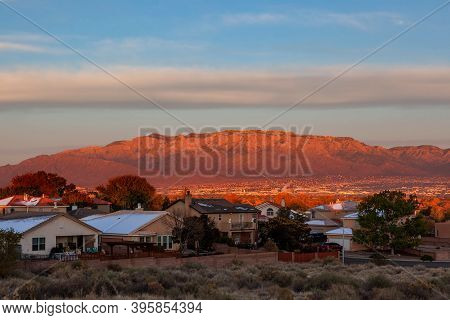 City Of Albuquerque And The Sandia Mountains, New Mexico In Fall Sunset