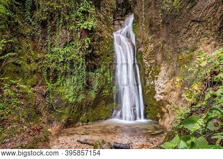 Landscape View Of A Colorful Waterfall And Small Basin At Bottom. Cerinski Vir, Samoborsko Gorje, Cr