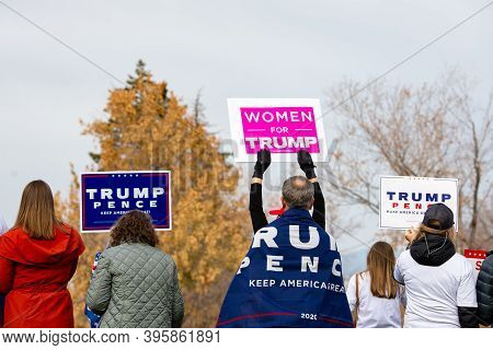 Helena, Montana / Nov 7, 2020: Protestors & Trump Supporters Holding For Trump And Women For Trump S