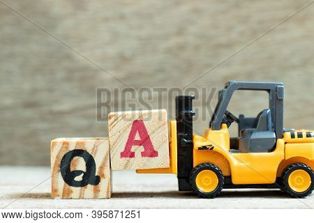 Toy Forklift Hold Letter Block A To Complete Word Qa (abbreviation Of Quality Assurance Or Question