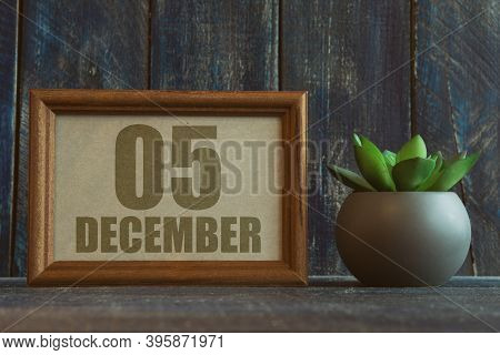 December 5th. Day 5 Of Month, Date In Frame Next To Succulent On Wooden Background Winter Month, Day