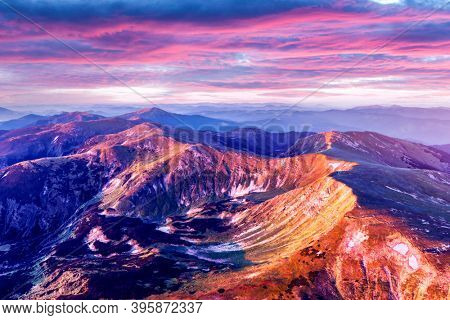 Hight mountains during purple sunset in spring season. Landscape photography