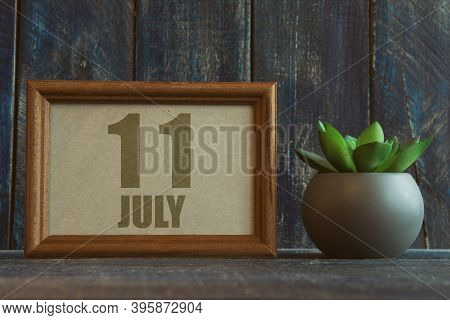 July 11th. Day 11 Of Month, Date In Frame Next To Succulent On Wooden Background Summer Month, Day O