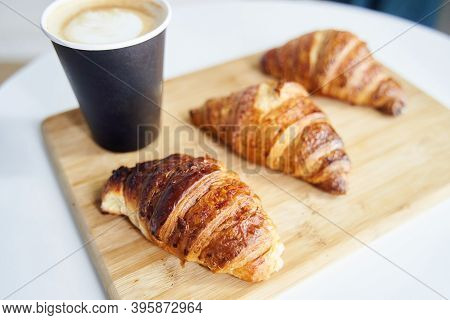 Golden Fresh Croissants With Coffee On A Wooden Tray Close Up