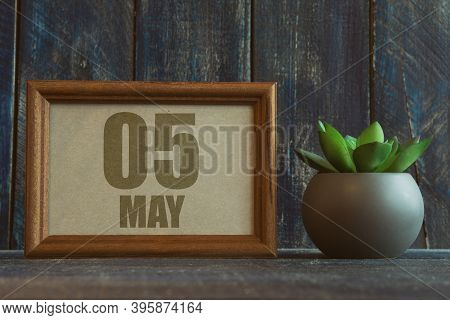 May 5th. Day 5 Of Month, Date In Frame Next To Succulent On Wooden Background Spring Month, Day Of T