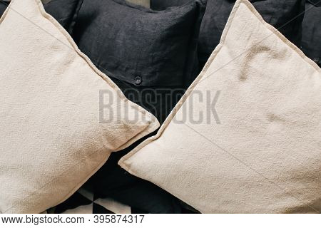 Cream And Black Cushions Or Pillows Setting On Sofa In The Living Room.