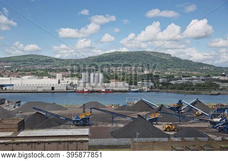 Belfast Dockland And Larsen Company With Carrs Glen And Napoleon's Nose In The Background In Belfast