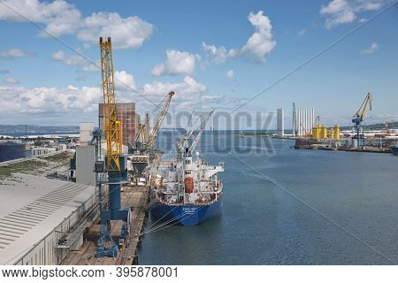 Large Industrial Cranes Loading Container Ship In Belfast Port In Ireland