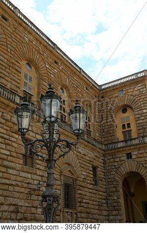 Detail Of Historic Pitti Palace In Florence In Italy With Lamps