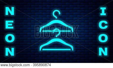 Glowing Neon Hanger Wardrobe Icon Isolated On Brick Wall Background. Cloakroom Icon. Clothes Service