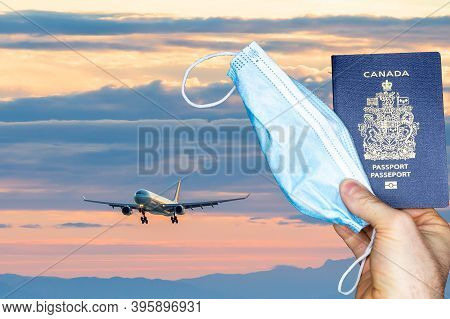 A Composite Of An Aircraft On Approach And A Passport And A Face Mask Representing Travel During Cov