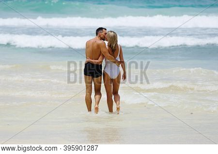 Beautiful Lover Couple Enjoy Their Honeymoon In Tropical Waters Of The Indian Ocean, Seychelles.