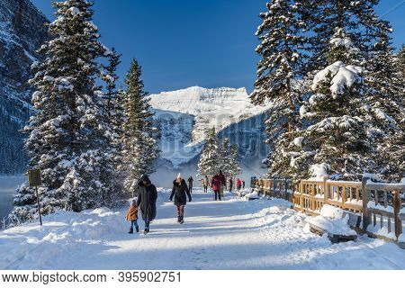 Alberta, Canada - Oct 10 2020 : Tourists Sightseeing At Lake Louise In Early Winter Sunny Day Mornin
