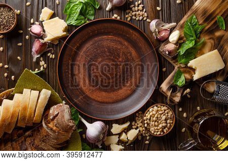 Flat Lay View At Food Background Of Genovese Pesto Sauce Ingredients On Wooden Kitchen Table With Co